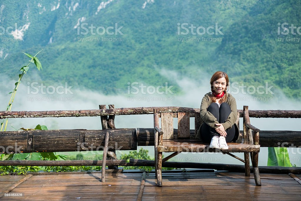 Smiling young woman With  Montains Background stock photo