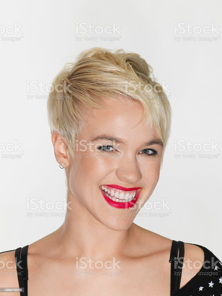 Smiling Young Woman With Red Lips stock photo
