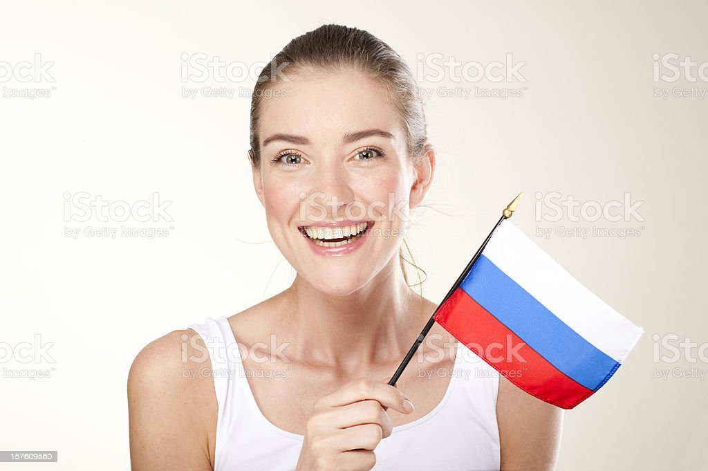 smiling young woman with Russian flag royalty-free stock photo