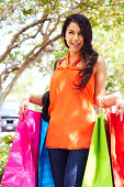 istock Smiling Young Woman With Shopping Bags 162332275