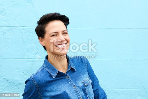 istock Smiling young woman with short hair and blue shirt 510393150