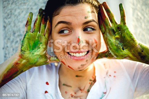 istock Smiling young women have a fun with colors 657874732