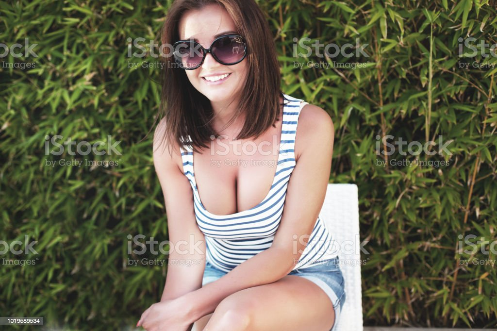 Smiling young women portrait outdoors stock photo
