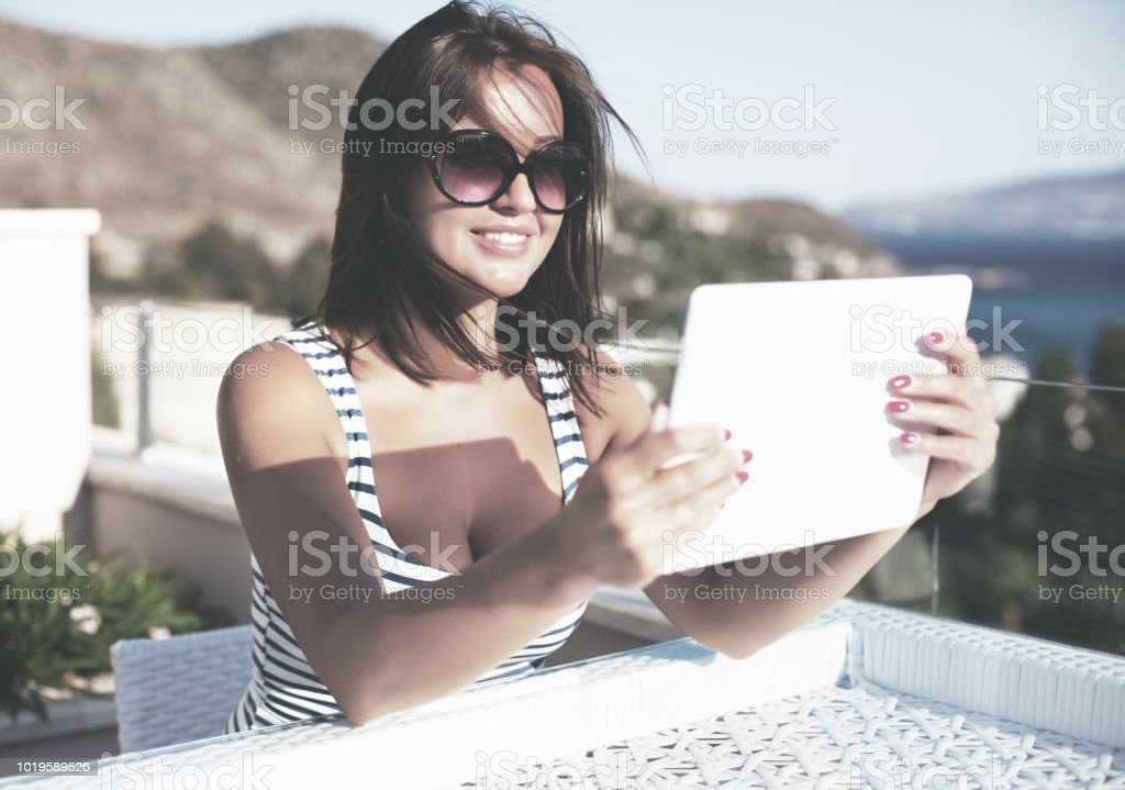 Smiling young women using digital tablet outdoor stock photo