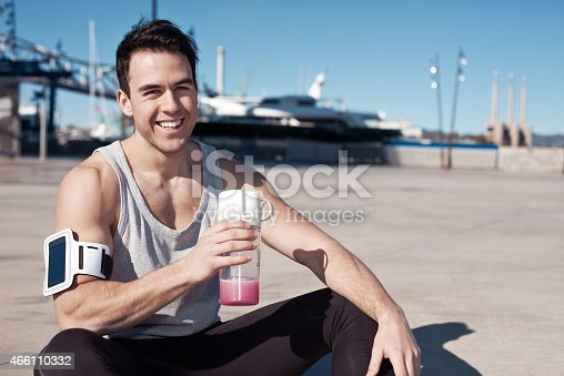 852024650istockphoto Smilingl athlete with protein cocktail 466110332