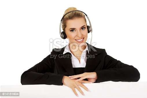 istock Smille call center woman holding empty banner. 614151604