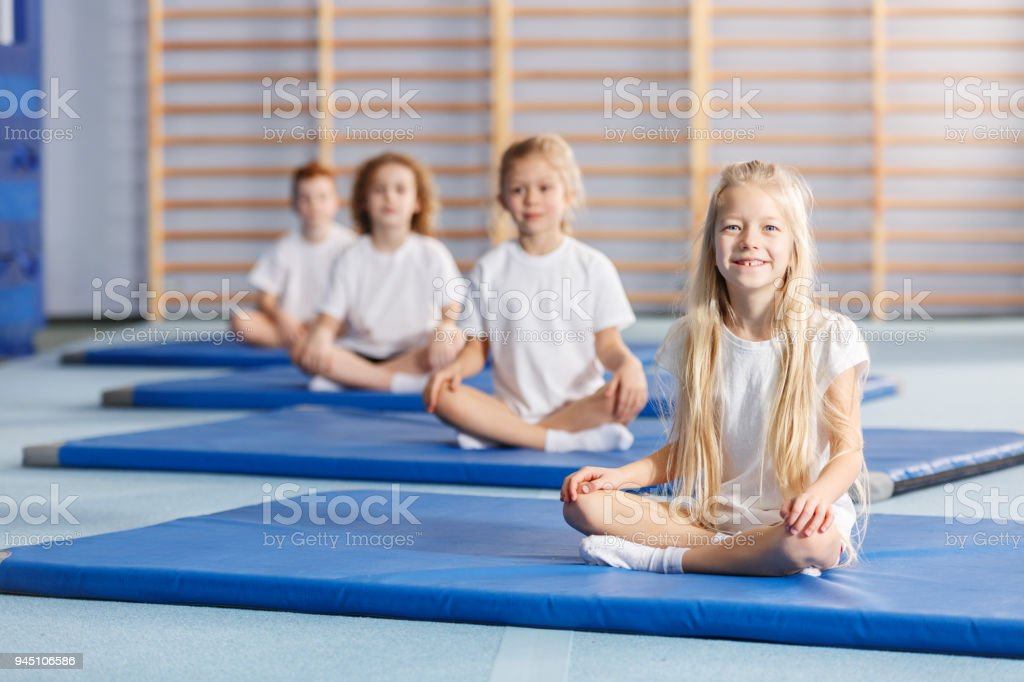 Smilling girl on blue mat royalty-free stock photo