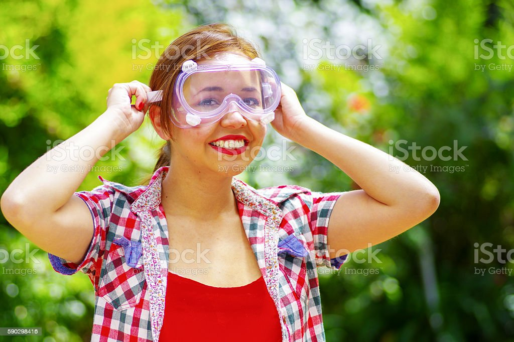 smilling women with colorfull clothes putting on security glasses royaltyfri bildbanksbilder