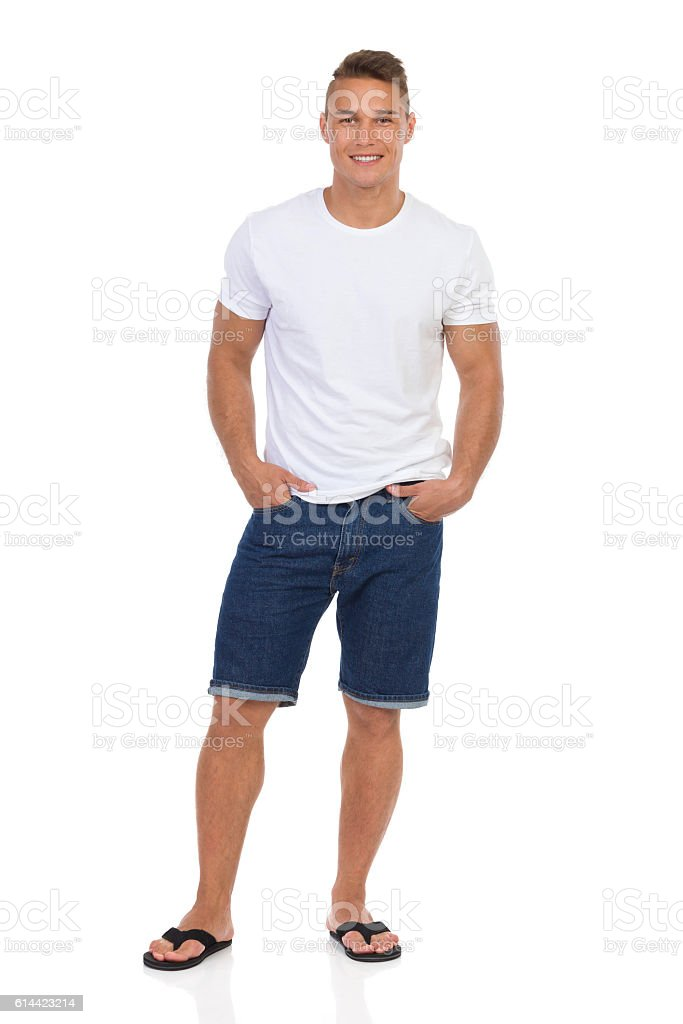 Smilng Handsome Man In Jeans Shorts And White T-Shirt stock photo
