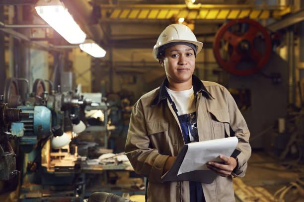 Smiloing Female Factory Supervisor stock photo