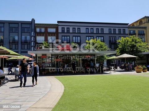 San Jose, California, United States - June 07, 2018:  People walk past Smitten Ice Cream in a bright, sunny outdoor square in the Silicon Valley, San Jose, California, June 7, 2018