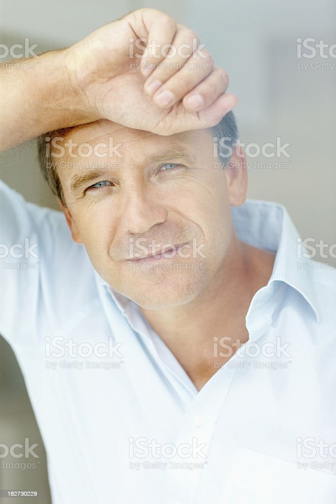 Smling mature man looking through glass window royalty-free stock photo