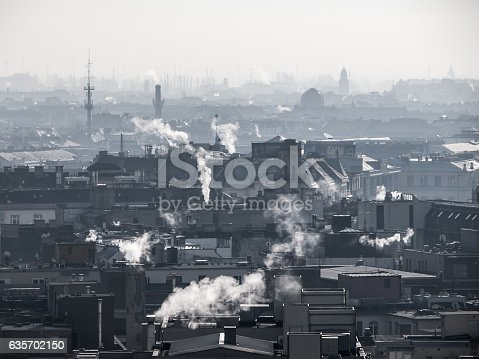 istock Smog - city air pollution. Unclear atmosphere polluted by smoke 635702150