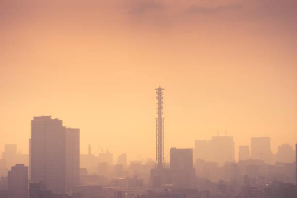 Smog filled Shinjuku Tokyo, Japan skyline stock photo
