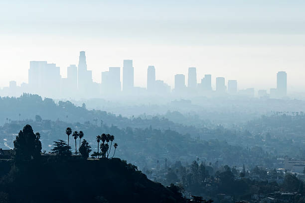 LA Smoggy Fog Downtown Los Angeles with misty morning smoggy fog. smog stock pictures, royalty-free photos & images