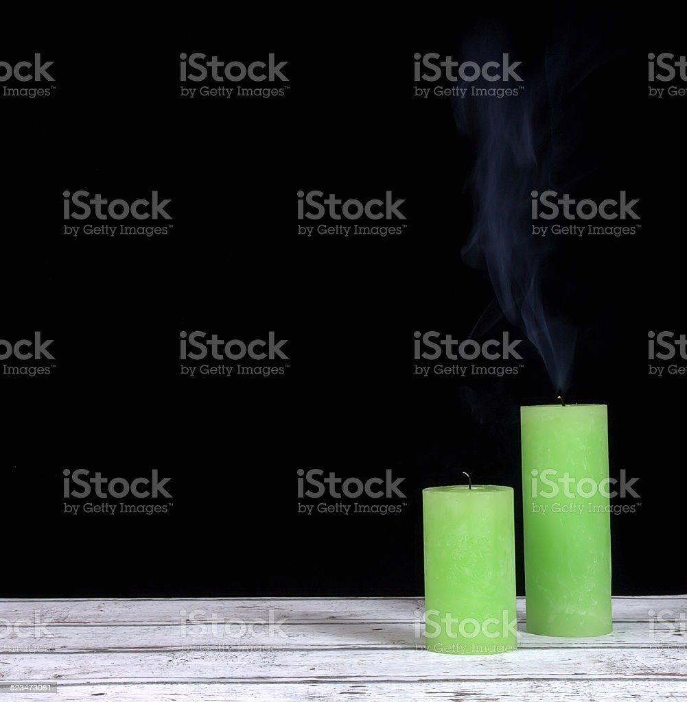 Smoke and extinct green candles stock photo