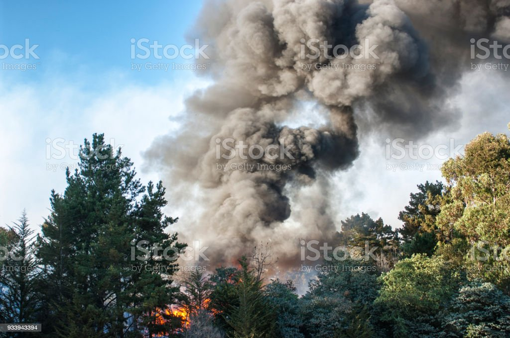 Smoke and Fire From Out of Control Wildfire stock photo