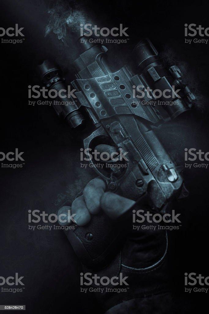 smoke and gun stock photo
