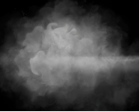 White smoke on black background with copy space.