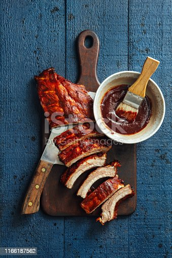 Grilled pork ribs with barbecue sauce on dark background