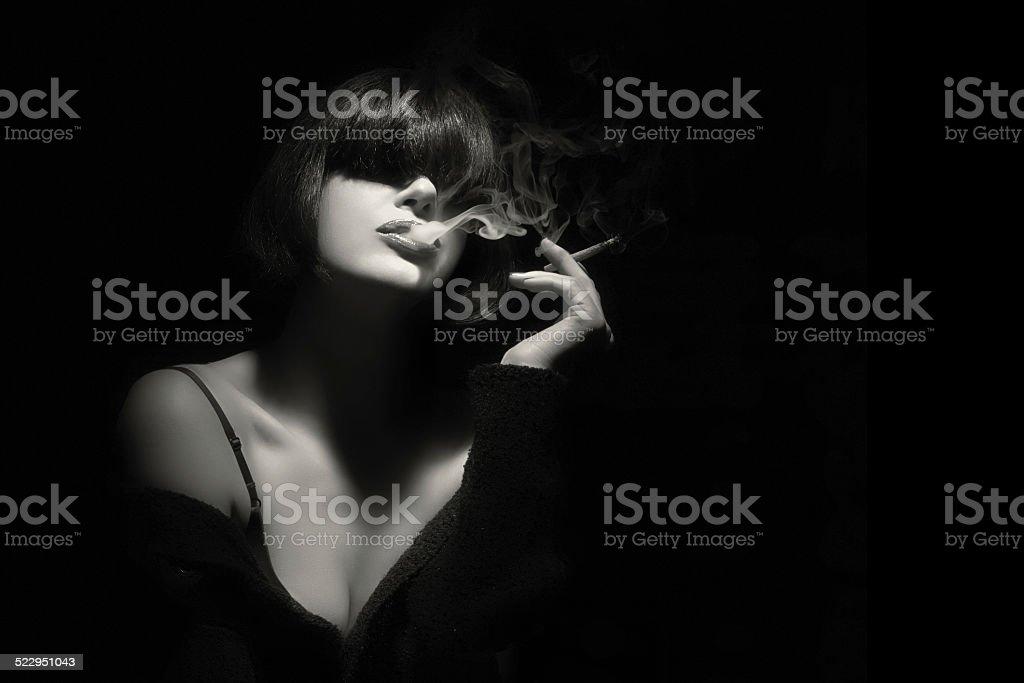 Smoke. Beauty Fashion Model Smoking a Cigarette stock photo