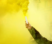 Smoke Bomb in Hand during Protest
