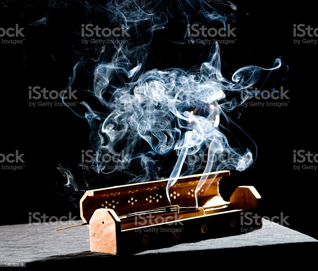 Smoke coming out of a wooden box with aromatic incense stock photo