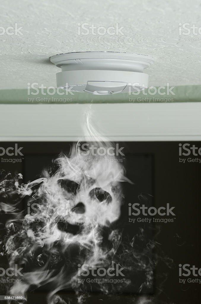 Smoke detector and smoke skull fire protection bildbanksfoto