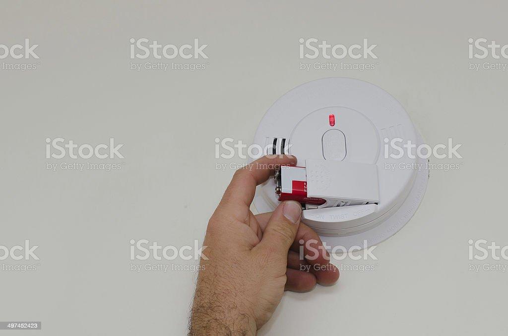Smoke detector battery replacement bildbanksfoto