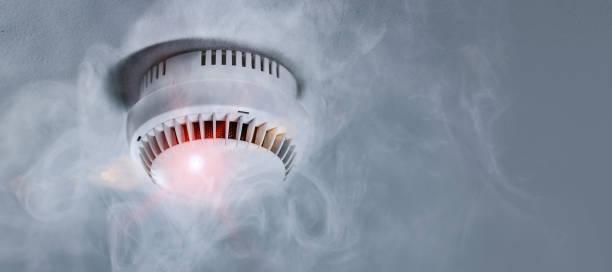 Smoke detector in apartment stock photo