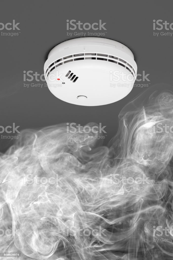 smoke detector of fire alarm in action stock photo