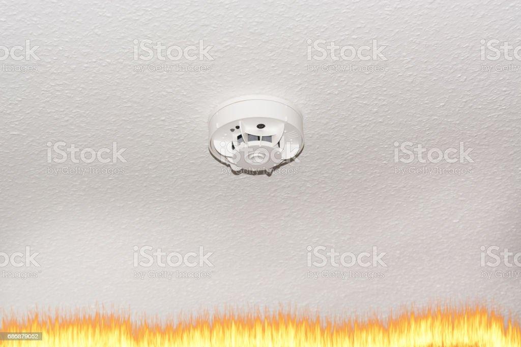 Smoke detector on the ceiling and smoke. stock photo
