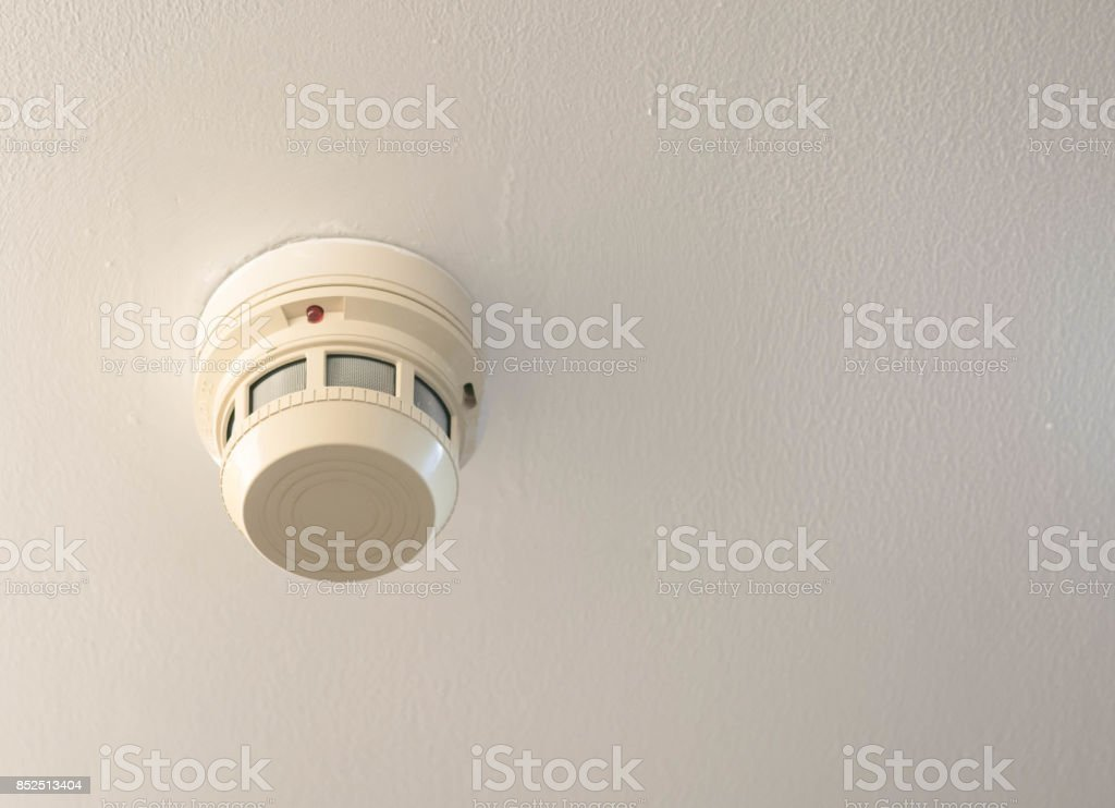 Smoke detector on the ceiling stock photo