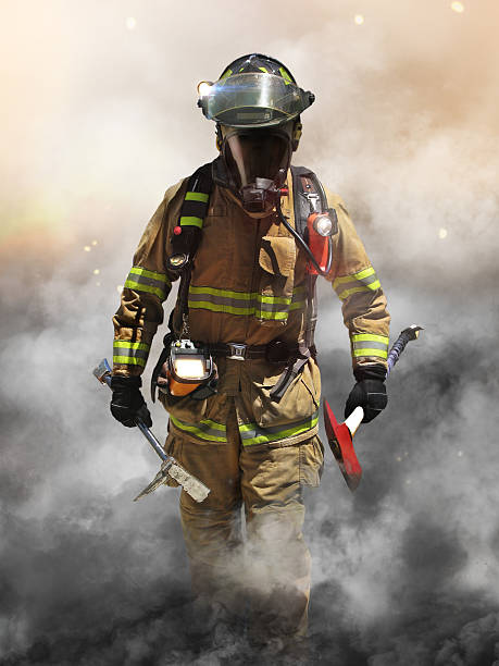Smoke eater A firefighter pierces through a wall of smoke searching for survivors. smoke jumper stock pictures, royalty-free photos & images