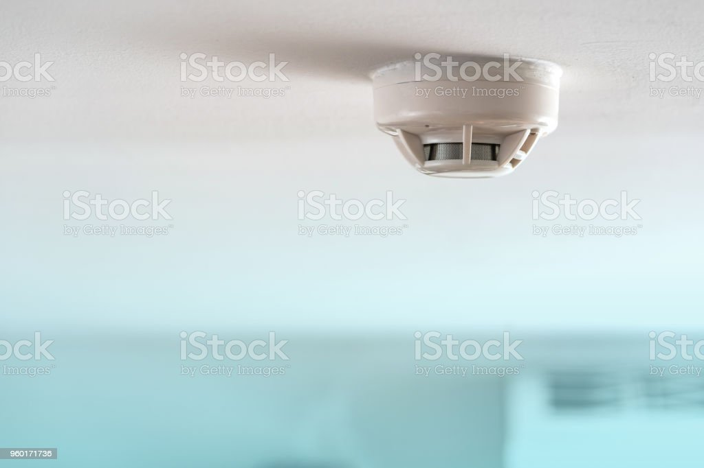 Smoke fire detector stock photo