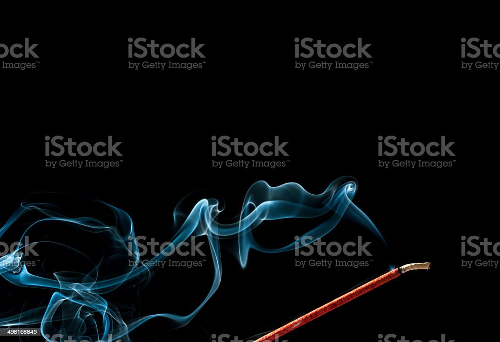 Smoke Flowing From A Burning Incense Stick stock photo