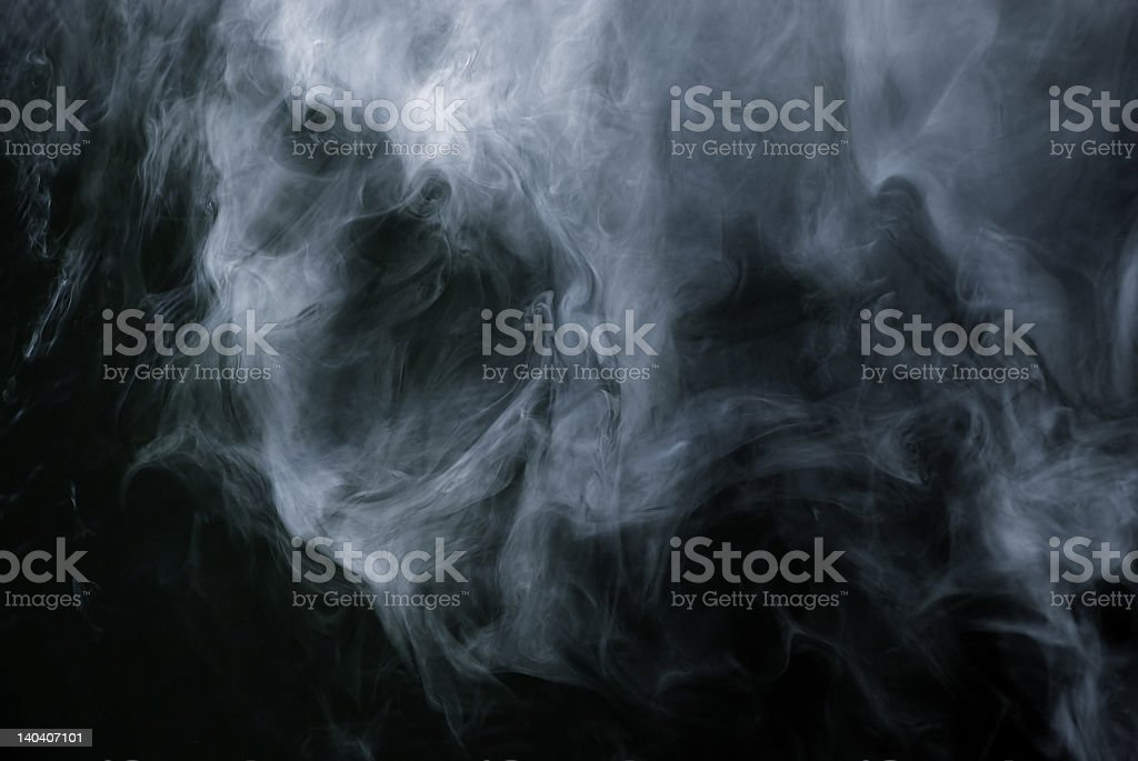 Smoke forming patterns on a black background royalty-free stock photo
