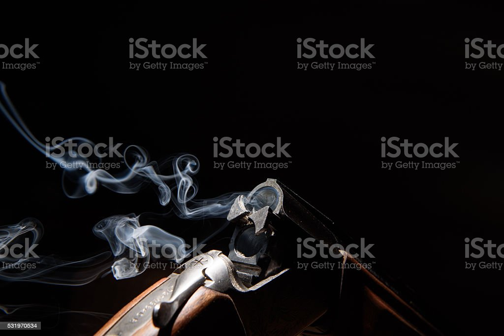 Smoke from a hunting rifle stock photo