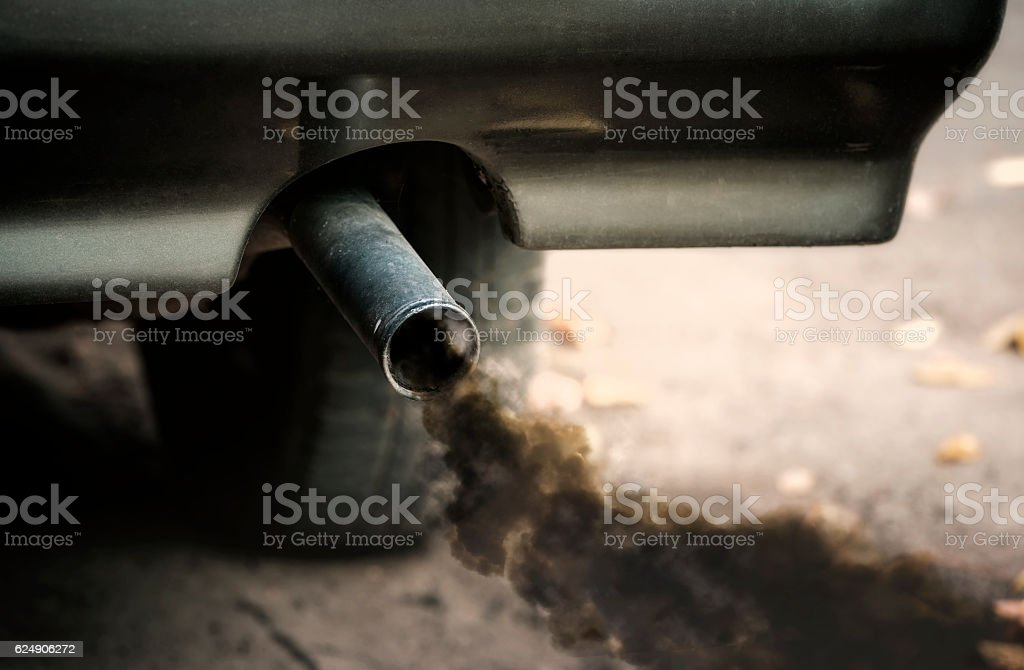 Smoke from  car pipe exhaust stock photo