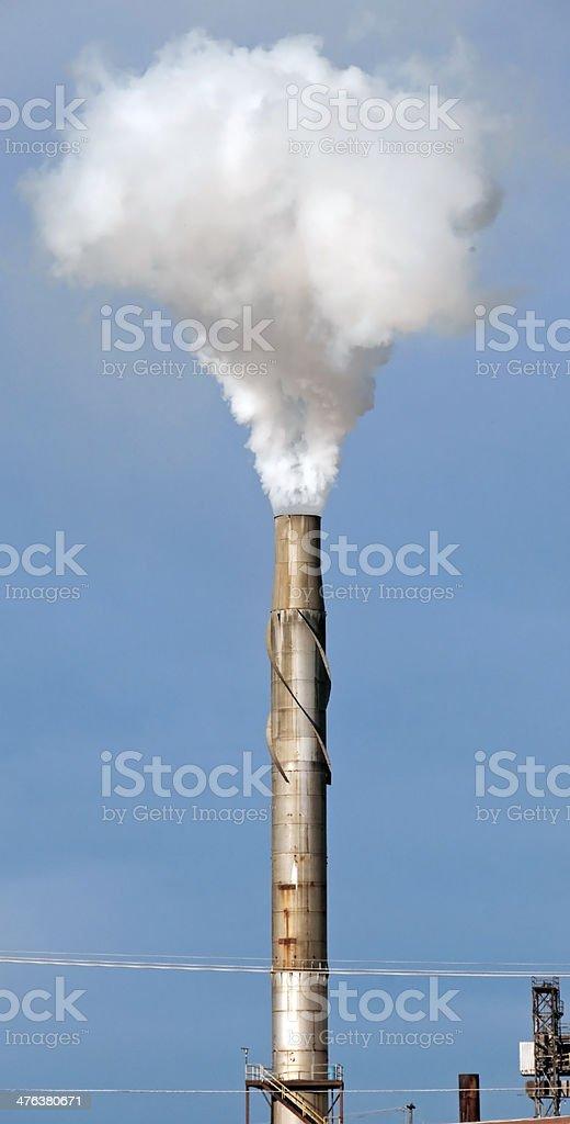 Smoke from chimney at sugar beet processing plant royalty-free stock photo