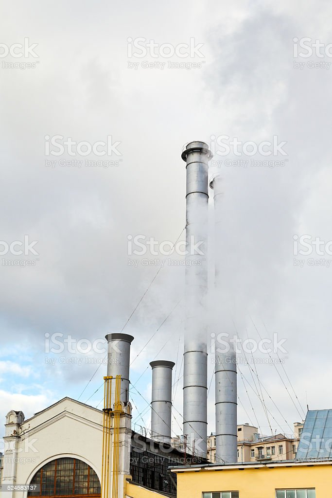smoke from chimneys of district heating station stock photo