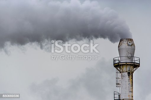 istock Smoke from factory pipe 830669336
