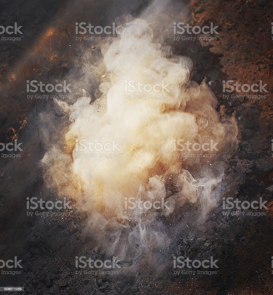 Smoke from fire on the ground stock photo