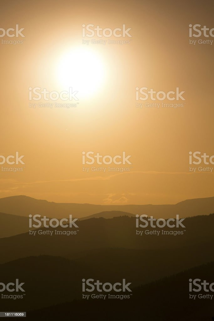 Smoke From Nearby Colorado Forest Fires Diffuses This Vail Sunset royalty-free stock photo