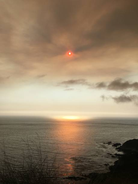 Smoke from the Californian wild fires over the ocean. stock photo