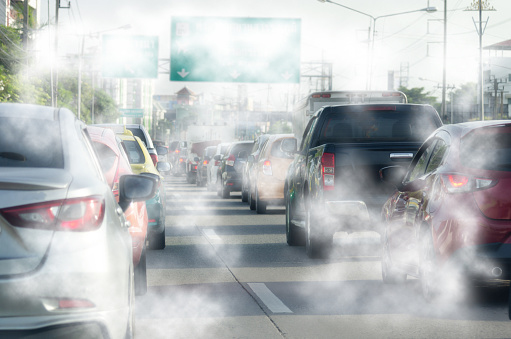 Smoke from the car exhaust on the road