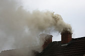 Smoke from the chimney of a house fueled with coal