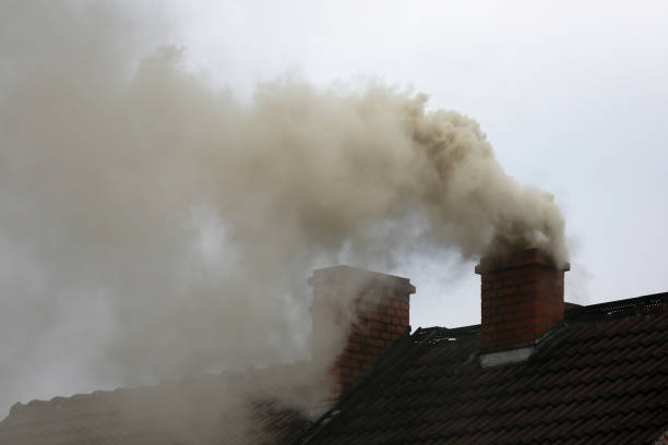 Smoke from the chimney Smoke from the chimney of a house fueled with coal smog stock pictures, royalty-free photos & images