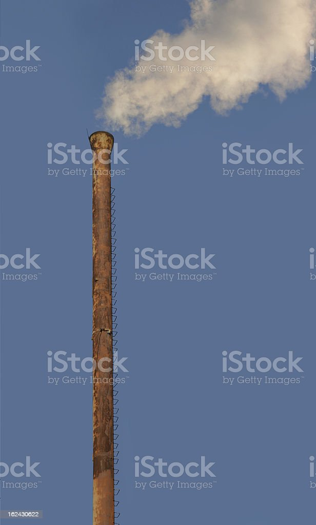 smoke from the chimney royalty-free stock photo