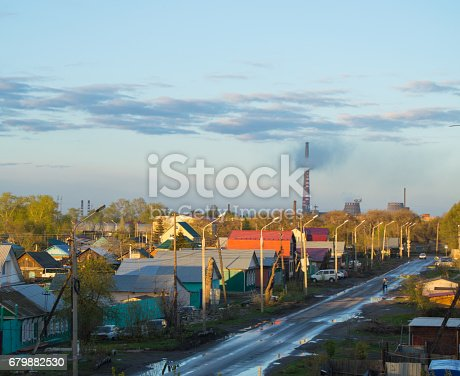 istock Smoke from the chimneys of boiler house in city near houses, problems of ecology 679882530